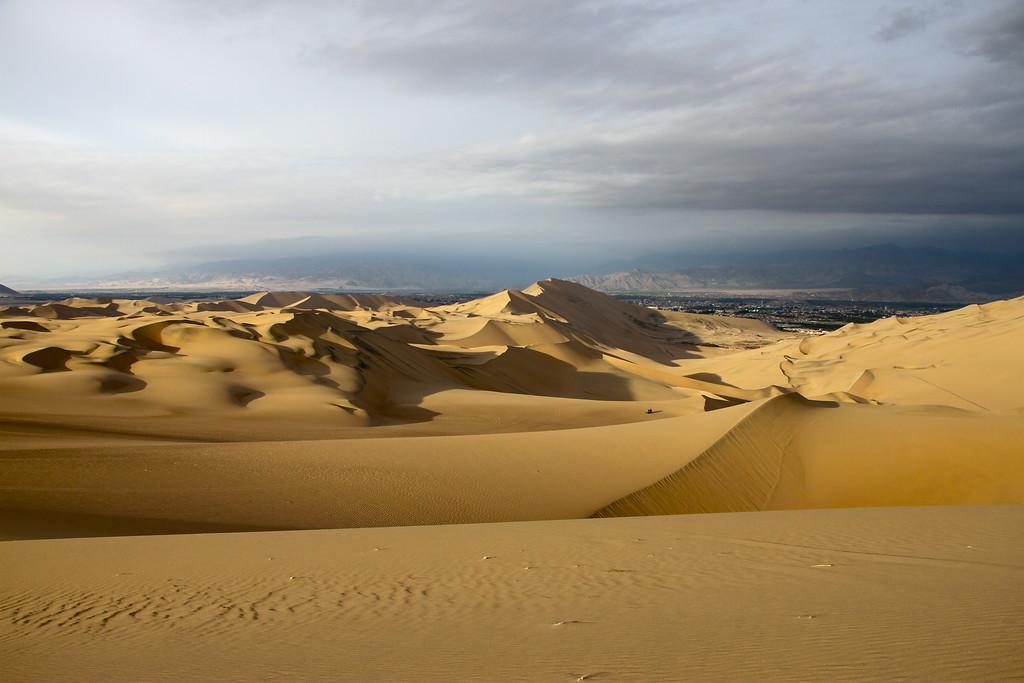 sand dune surfing Peru