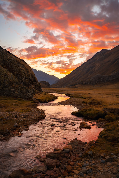 Sunset over a river in the Huayhuash
