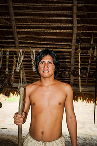 A young Bora Tribesman holding a traditional staff, Iquitos, Peru, Amazon, South America