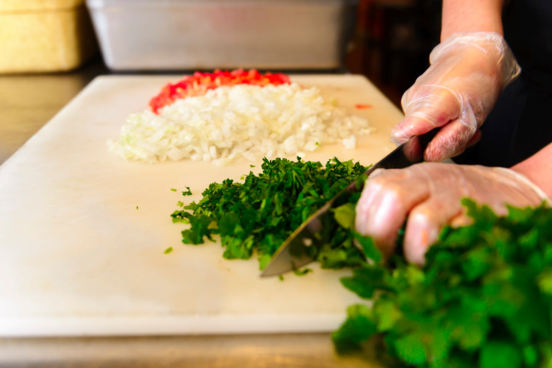 Ingredients, chopping cilantro at Ohio City Burrito