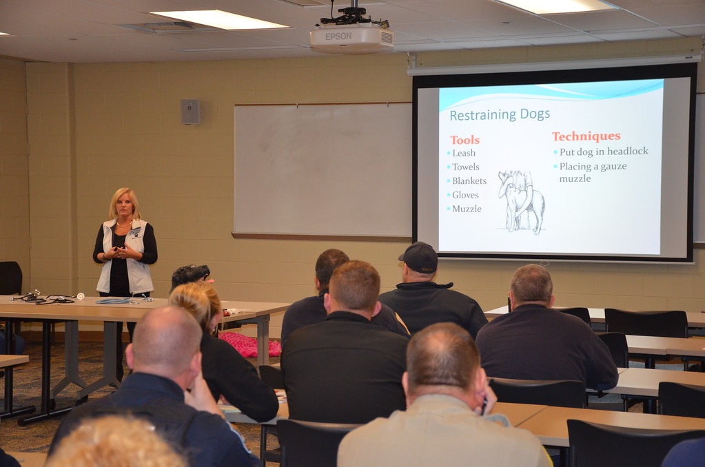 . Lori Renda-Francis, director of the Macomb Community College\'s veterinary technician program, leads a pet first aid/CPR clinic for police and fire personnel.