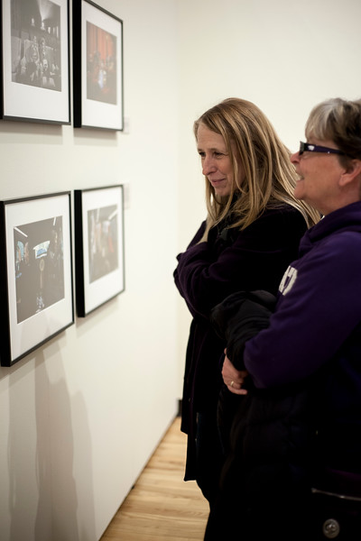Gallery attendes browse Pete Souza's photograph at the Beach Museu. Marianna Kistler Beach Museum featured the White House photohgrapher on Feb. 5, 2019. <br /> ( Alanud Alanazi | Collegian Media Group)