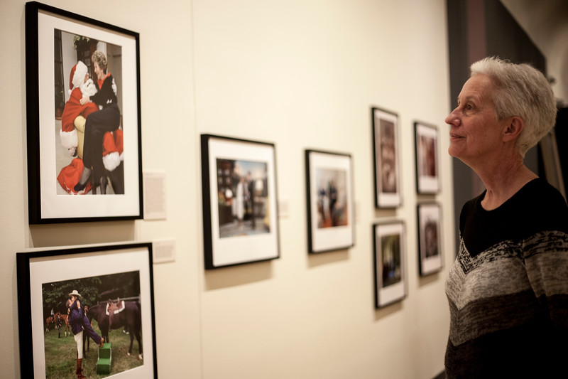 Gallery attende browse Pete Souza's photograph at the Beach Museu. Marianna Kistler Beach Museum featured the White House photohgrapher on Feb. 5, 2019. <br /> ( Alanud Alanazi | Collegian Media Group)