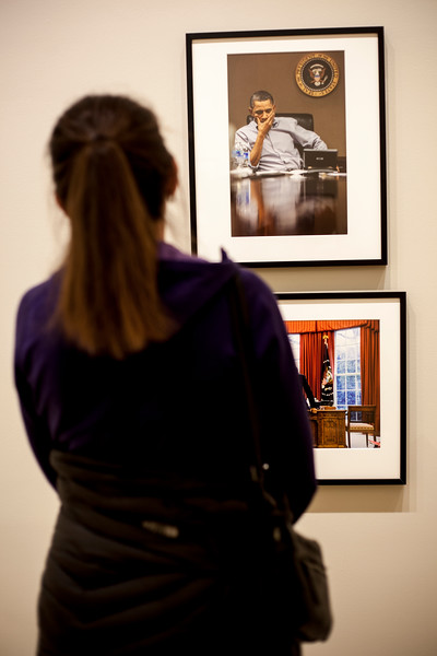 Gallery attendes browse Pete Souza's photograph at the Beach Museu. Marianna Kistler Beach Museum featured the White House photohgrapher on Feb. 5, 2019. <br /> ( Alanud Alanazi   Collegian Media Group)