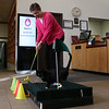 "HOLLY PELCZYNSKI - BENNINGTON BANNER Karson Kiesinger, Reference and Adult Librarian at the Bennington Free Library attempts to make a hole in one while ""Pete the Cat"" takes up the green, on Monday afternoon. The Green is a practice hole for the upcoming Library Mini Golf taking place Feb. 28 & 29 open to all to take place in the 18 hole mini golf course while exploring the library and taking place in some indoor fun."