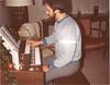 Peter 1983 playing organ