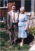 Peter in gray suit with Jean in front of front door 1987