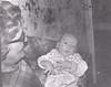 Doris Stanton (Robson) holding David Arpin in kitchen