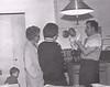 Stephen, Doris Stanton, Margaret, Andre holding David in kitchen