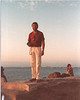 Peter Lantz standing near water holding camera