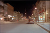 Front Street, Belleville Ontario looking south towards City Hall. McIntosh Brothers, SS Kresge, Leslie's Shoes, etc. Night time image