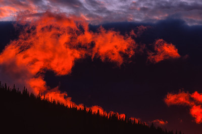 Sunset lights up a cloud on the horizon, Yukon