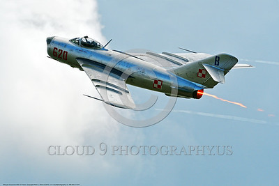 WB-MiG-17 00047 A climbing Mikoyan-Guryevich MiG-17 Fresco Soviet Cold War era supersonic jet fighter in afterburner and Polish Air Force markings at Thunder Over Michigan 2016 airshow warbird picture by Peter J  Mancus