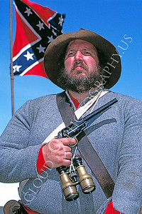 HR-ACWR 00003 A proud southern American Civil War rebel historical reenactor holds his pistol standing before the Confederate flag, by Peter J Mancus