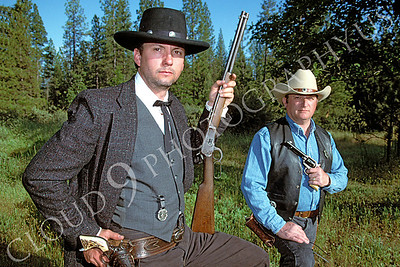 HR-ACB 00004 American cowboy historical reenactors--two, one with rifle and one with pistol, by Peter J Mancus