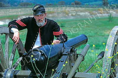 HR-ACWY 00002 A Yankee artillery man American Civil War historical reenactor leans on his canon, by Peter J Mancus