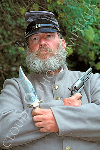 HR-ACWR 00001 A southern American Civil War rebelhistorical reenactor holds a knife and a pistol, by Peter J Mancus