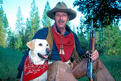 HR-ACB 00002 American cowboy historical reenactor with dog, shotgun, scarf, chaps, and hat by Peter J Mancus