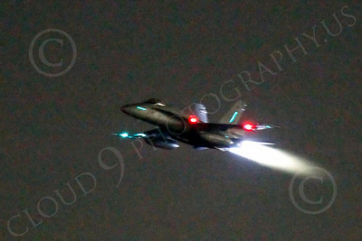 AB - F-18USN-L 00014 McDonnell Douglas F-18 Hornet US Navy in afterburner at night by Peter J Mancus