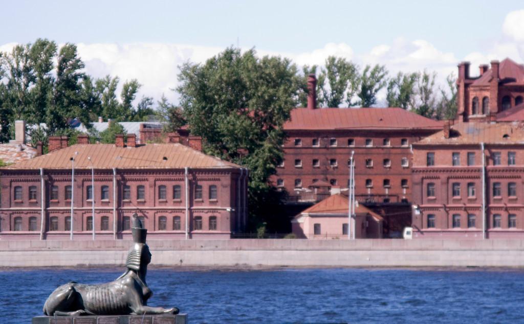 """Robesp'er embankment, monument by Shemyakin. On far bank - Prison """"Kresty""""."""