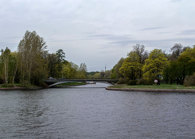View to the small bridge at the Stone island from the Sandy quay of the Low Nevka.