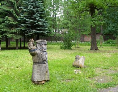 Stone island, Birch alley, old wooden sculpture