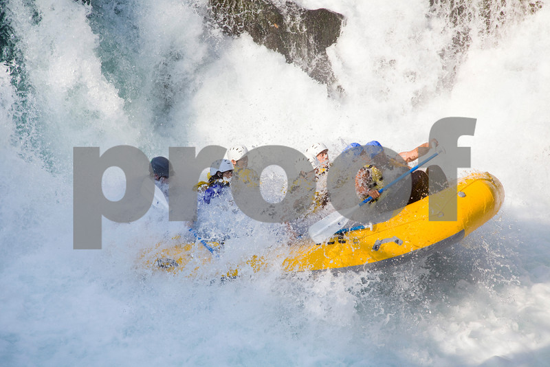 Rafters engulfed in water after going over Husum Falls on the White Salmon River.
