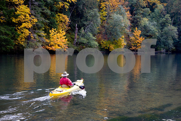 Kayaker on Northwestern Lake, White Salmon River Washington.