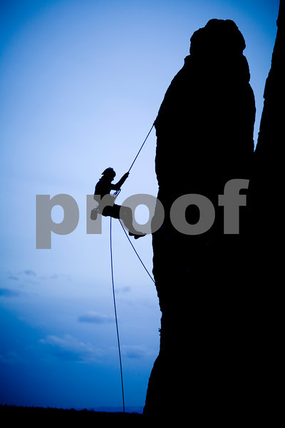 Rock climber rappelling, sunset at Smith Rock Oregon.  Release Form signed.