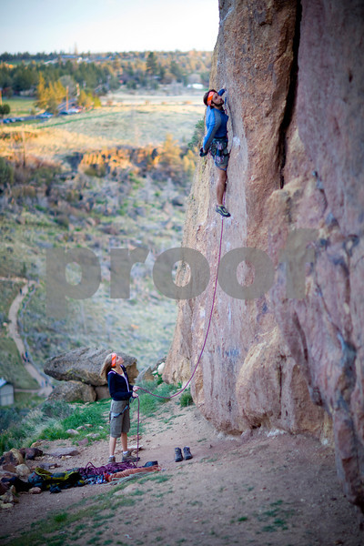 Male and female rock climbers at Smith Rock Oregon.  Release forms signed.