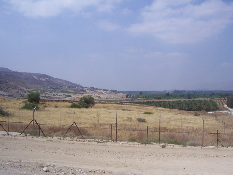 """The next several photos are of climbing the southern end of the Golan, which is right along the fence between Israel and Jordan.  It may look like a pretty flimsy fence, but there are plenty of signs warning those who would cross that they just might run into little nuisances called """"land mines.""""  Upon hearing that, I'm deterred from doing a little fence-jumping."""