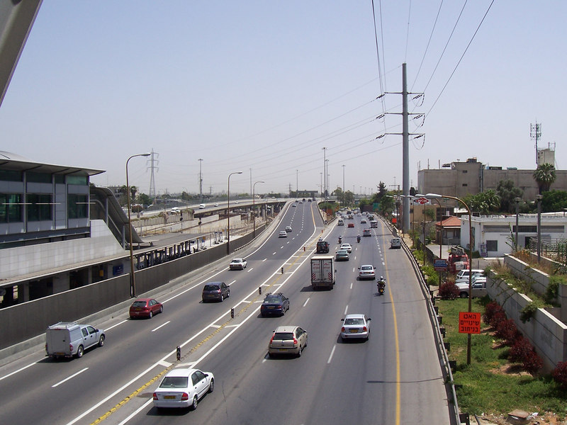 """LOOK!! They have roads and cars here too!! This is a view of something they call a """"highway""""...this crazy """"mega-road"""" runs north and south through Tel Aviv.  On the left is a train station.  These Israeli's...what WILL they think of next??"""