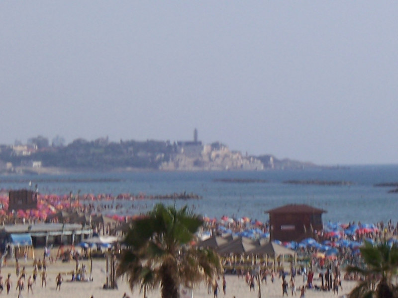 Believe it or not, beaches ARE popular here.  Who would have guessed?  Taken from a sidewalk overlooking the beach, looking southward.  The city in the distance is an older city called Jaffa.  And yep, that blue stuff- that's the Mediterrean Sea.