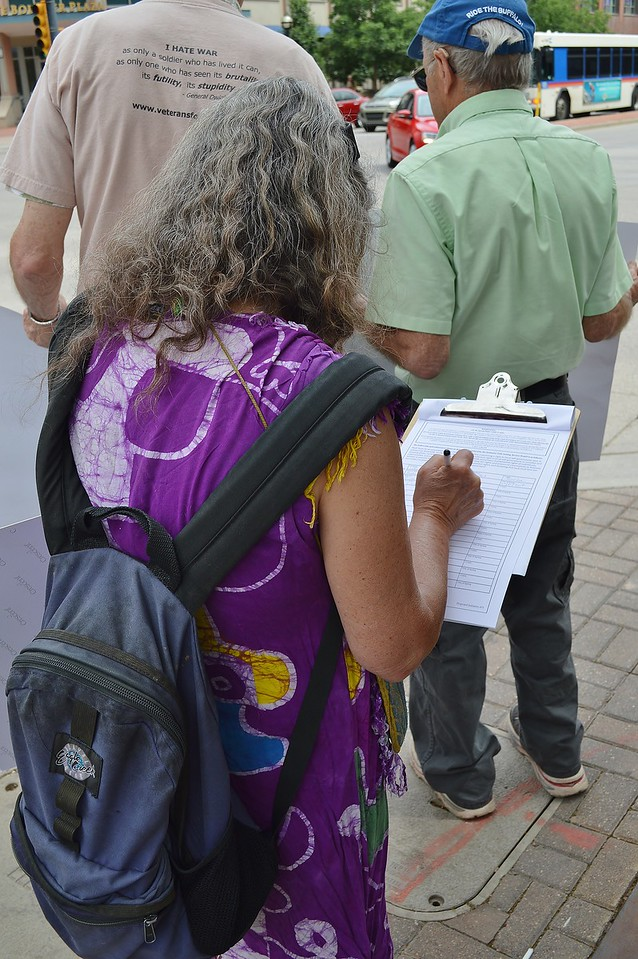 Woman signing petition.
