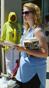 Young woman holding clipboard and Hillary Clinton book.