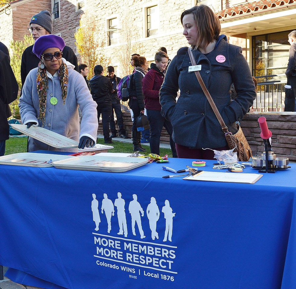 Colorado WINS members staffing a table at union rally for better wages.