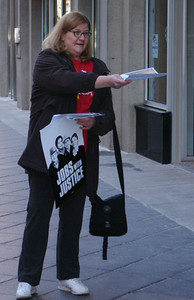 Jobs With Justice activist leaflets outside Verizon store in downtown Denver. (12/10/11)