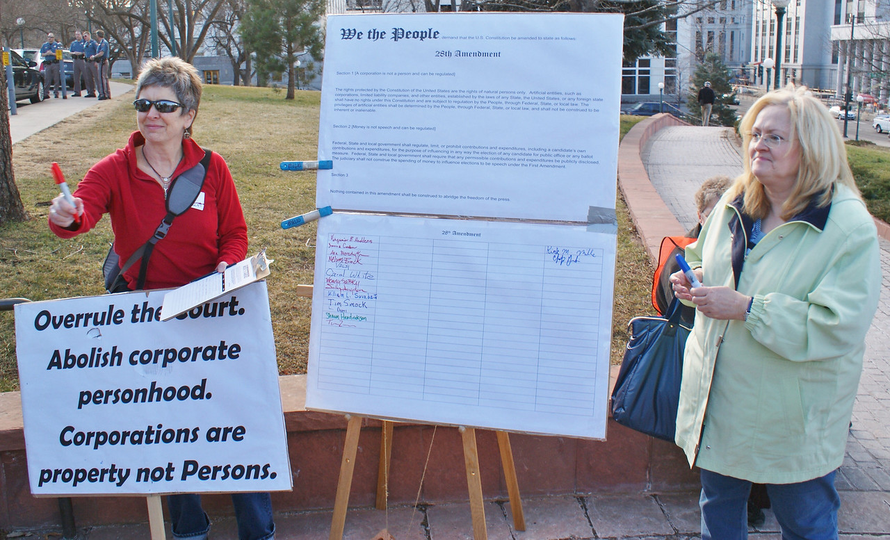 """Denver area residents gather signatures on a  petition to abolish """"corporate personhood"""". (1/20/12)"""