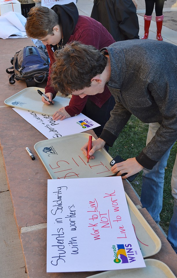 Union supporters making signs for a rally for a $15/hr wage at the University of Colorado in Boulder.
