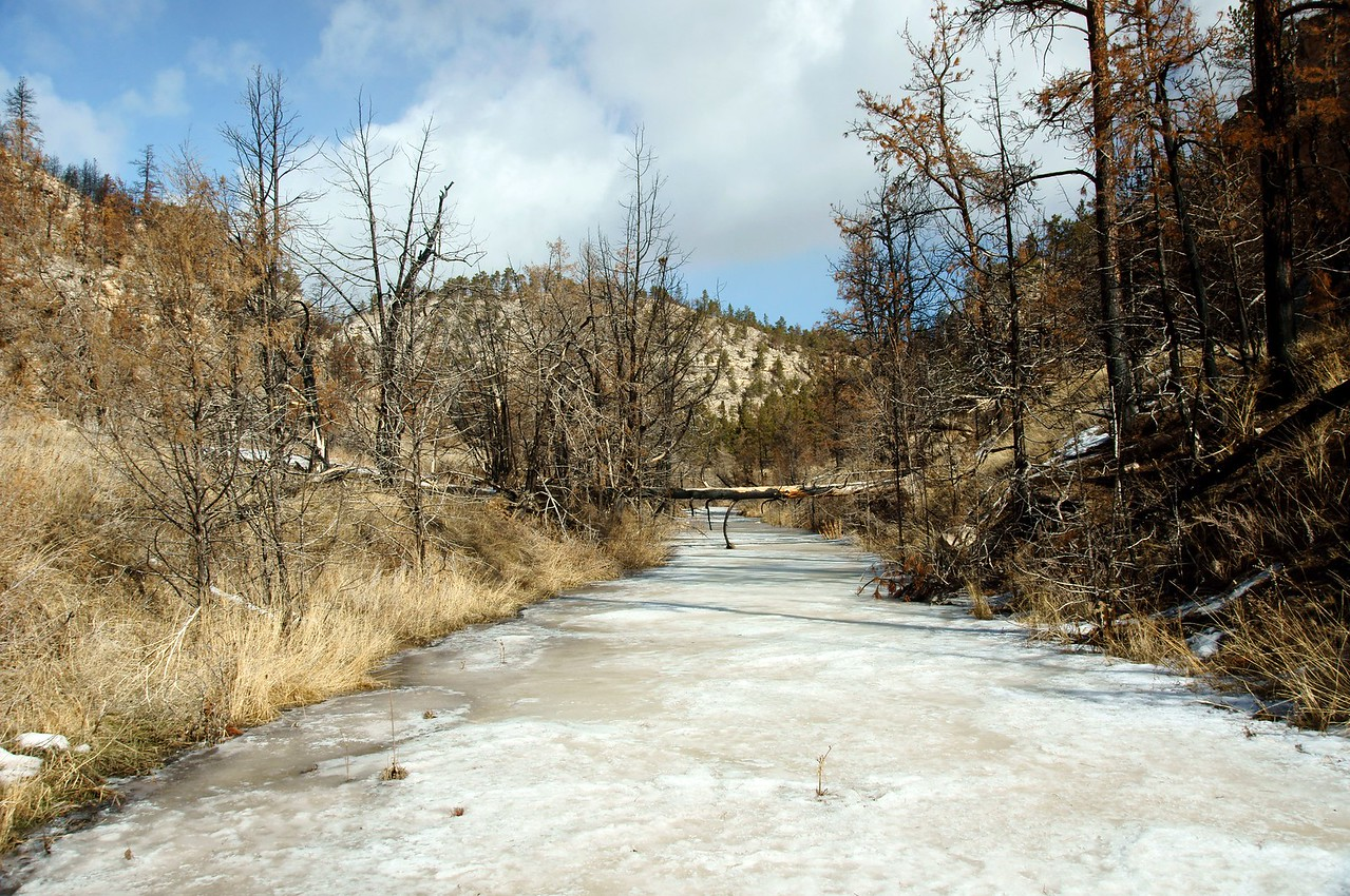 Crossing frozen river in bottom of the canyon.