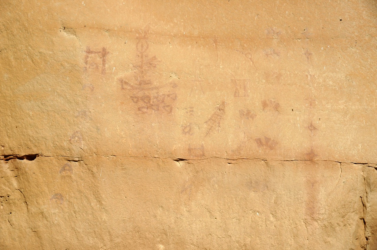 1st panel of pictographs.  There appears to be stars on the right hand side.  The left side looks like some kind of tracks walking into an opening.