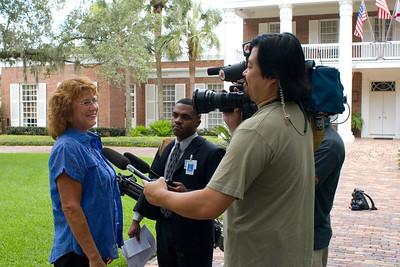 Press interviewing Ronda Federspiel, Governor Crist's top aide.