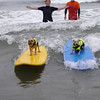 Cleo and Snow expertly share a wave!