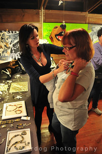 Maureen tries on a necklace with Char's help.