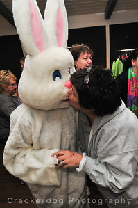 Robin plants a smooch on Laze in the bunny suit.