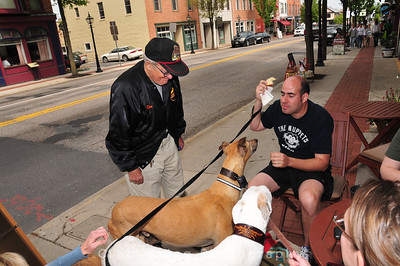 Passerby talks to PJ about greyhounds