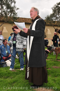 Father Gerald explains the purpose of blessing the hounds