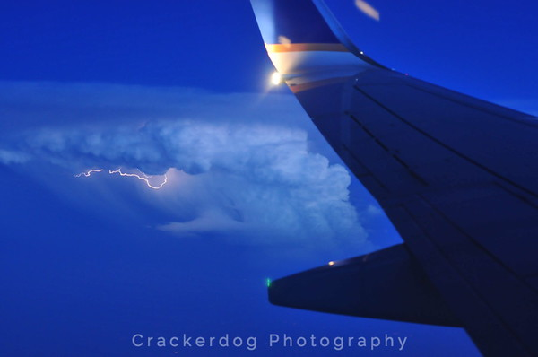 Lightning illuminates a thunderstorm somewhere in the Midwest.