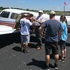 Unloading Pilot Shawn's plane.