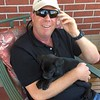 Pilot Shawn relaxes with a pup.